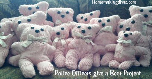 Police Officers give a bear